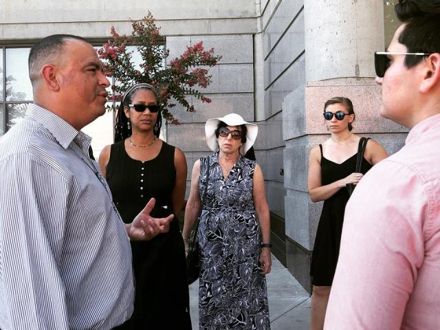 Researchers talking to local activist in Stockton, CA