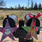 Signs on mailboxes that say strong and hope