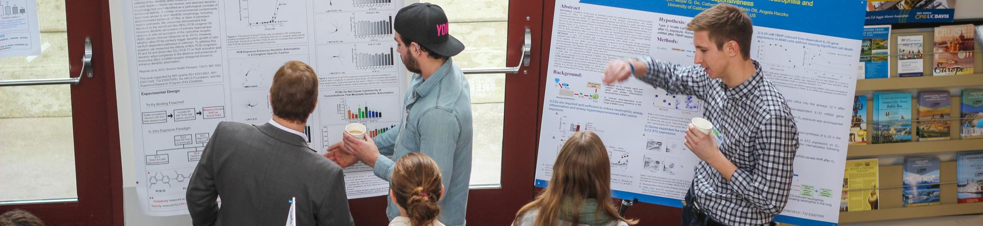 Scientists at poster presentation